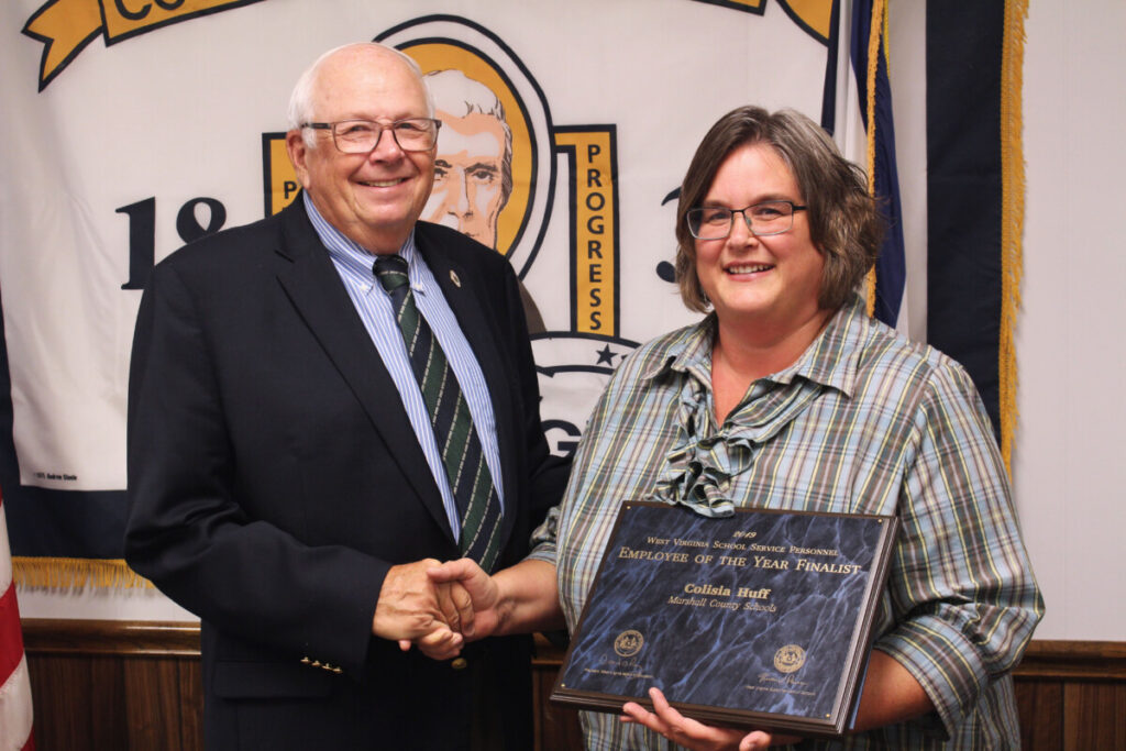 Pictured from left: WV BOE member Dr. James Wilson congratulates WLES Pre-K Aide Colisia Huff for being named a finalist for the WV Service Personnel Member of the Year Award.