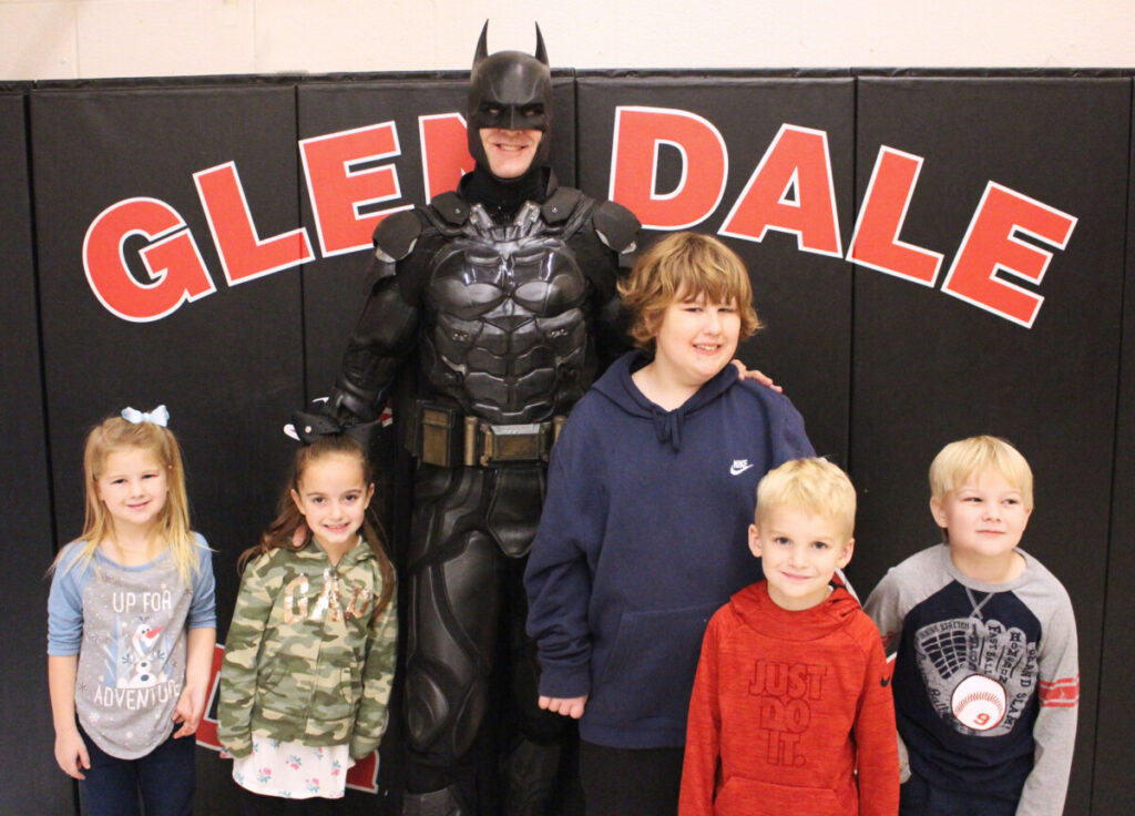 Pictured from left with Batman: Leana Roberts, Gabby Dantrassy, Dylan Burgy, Colton Scherich and Liam Nickerson.