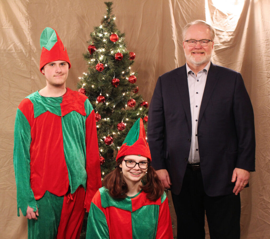 Pictured from left: Elf Lucas, Elf Caitlin and GKT Attorney Christopher Turak.