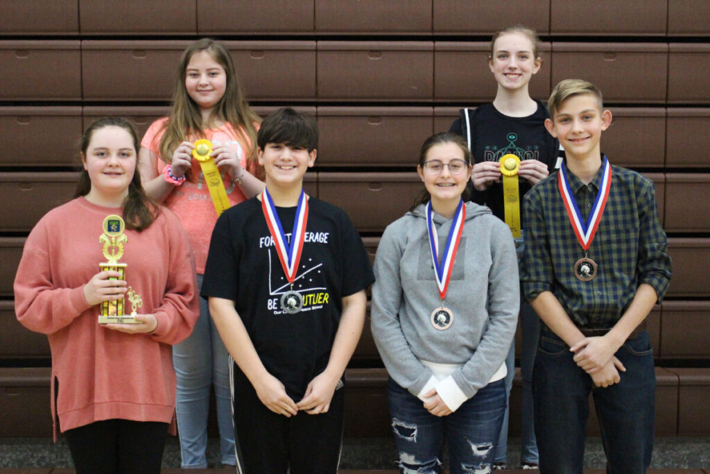 8th grade Winners (L to R) Back Row: Kelsie Schenerlein (alternate), Megan Williams (alternate) Front Row: Lilly Roman (1st), Nate Smith (2nd), Alexis Cumberledge (3rd), Jude Thomas (4th)