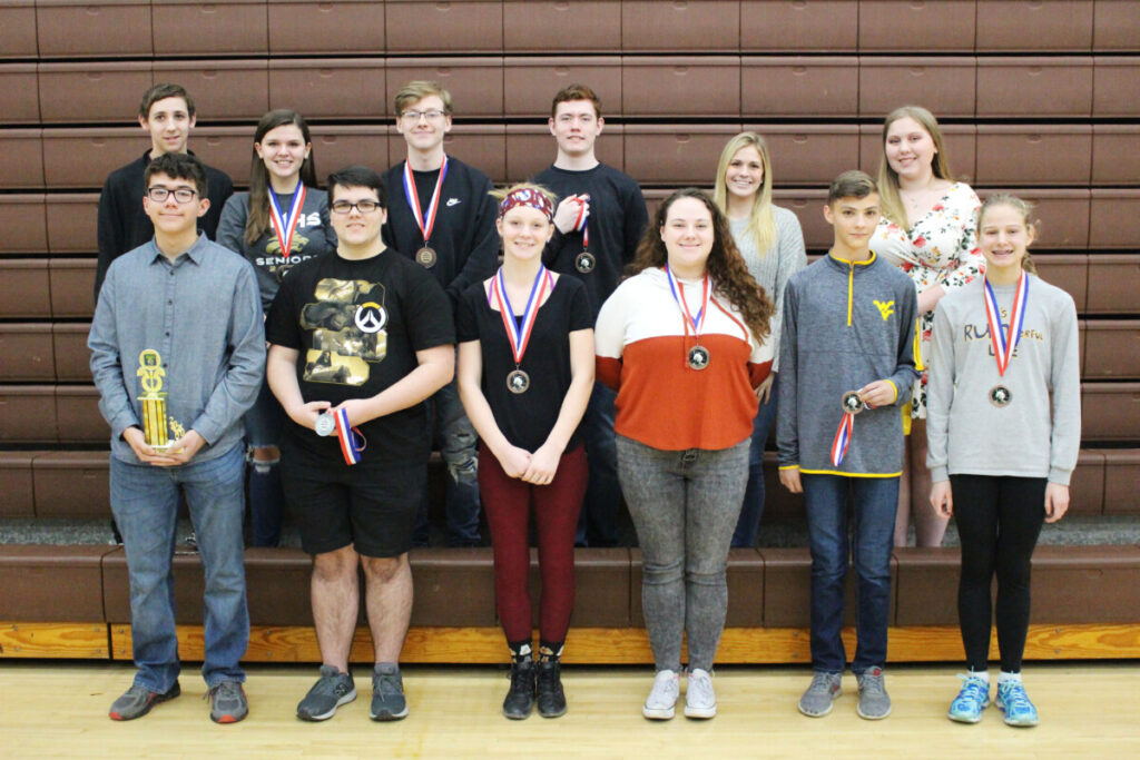 High School Winners (L to R) Back Row: Colton Asbury (7th), Emily Anderson (8th), Walter Heitz (9th), Fred Carroll (10th) Emilee Kettler (alternate), Kiersten Schenerlein (alternate) Front Row: Nate Flowers (1st), Matthew Hill (2nd), Josilee Scott (3rd), Jillian Blackburn (4th), Jackson Thomas (5th), Zara Zervos (6th) Not pictured: Ben McCardle (alternate), Timothy Wilson (alternate), Kalyn Sobutka (alternate)