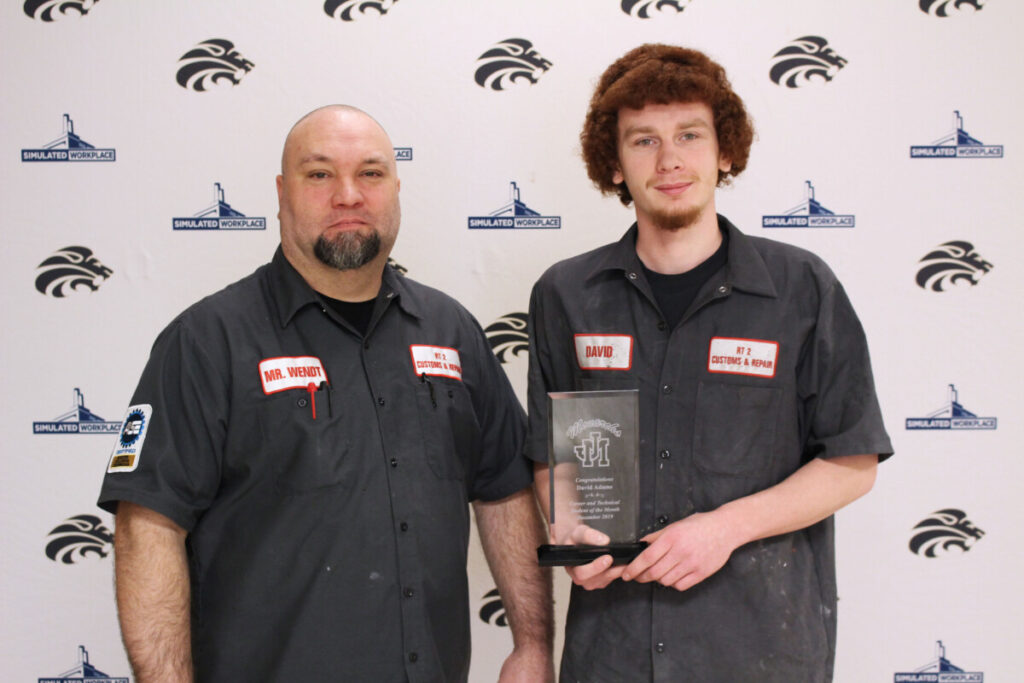 From left: Collision Repair teacher Joe Wendt and David Adams.