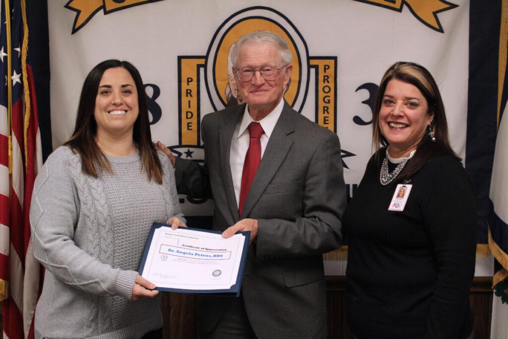 Pictured from left: Dr. Angela Petros, DDS, BOE President John Miller and Student Services Director Karen Klamut.