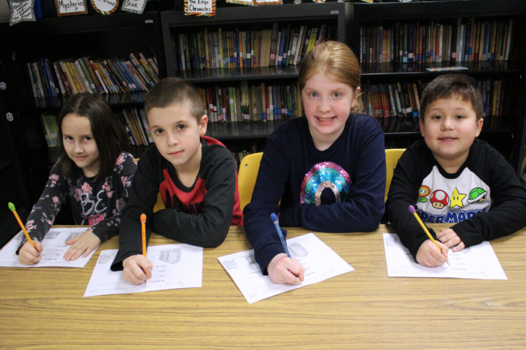 Pictured from left: CMES students Tapanga Antill, Grace Evans, Jack Barton and Dexter Choi, along with all of their classmates, filled out a mock census survey Thursday afternoon.