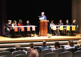 Students compete at the Marshall County WV History Bowl on the stage of the Mound Museum.