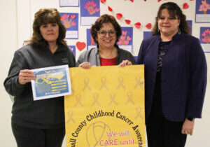 Pictured from left: Representing the Marshall County Childhood Cancer Awareness Corporation are Brenda Frohnapfel and Brenda Crow with Marshall County Schools Superintendent Dr. Shelby Haines.