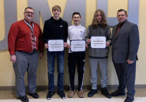 From left: JM Assistant Principal Geno Polsinelli, Brennan Sobutka, Tyke Muldrew , Quentin Bess and K of C Council 1907 Grand Knight Lewis Richmond.