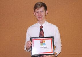 Justin Jones, Strings teacher with his MAC certificate