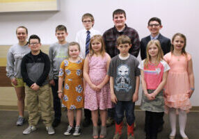 Students who read their stories during the Young Writers Tea are pictured from left. Front row: Zane Gast, Maggie McGlumphy, Addison Mlodzik, Hugh Hagan, Liberty Cuffaro and Ava Kimmins. Back row: Trixie Calissie, Owen Berisford, Joshua Meneely, Thaddeus Dempewolf and Jasper Murrin.