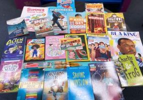 Various Scholastic books spread out on a table.