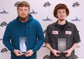 from left holding their CTE Students of the Month plaques are Hunter McCamick and David Adams.