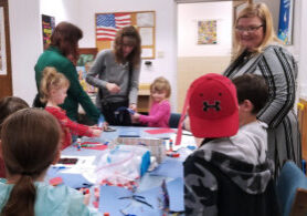 Kids making Cat in the Hat crafts.