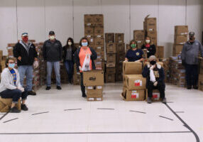 Pictured from left are just a few of the many School Lunch Heroes who have been packing and delivering food to Marshall County students: Missy Francis, Chuck McClure, Rick Kinkes, Heather Loy, Jessica Snider, Kelly Daugherty, Norma Whipkey, Sandy Kotson and Kenny Richmond.
