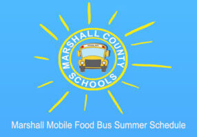 Marshall County Logo circle with a bus in the middle with sun rays around in yellow