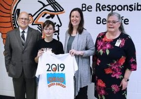 During an assembly Wednesday afternoon, Moundsville Middle School 8th grade student JoLeigh Young was presented a $500 check for winning the T-Shirt Design division of the Ohio River Sweep Poster Contest.