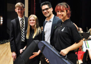 Pictured from left: Strings teacher Justin Jones, Sherrard Middle School student Abby Riggle, Sound Impact representative Juan Jaramillo and Moundsville Middle School student Annadra Dudley.