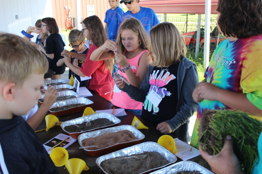 Central Elementary students learn about the layers of the earth by making their own test-tube soil sample.