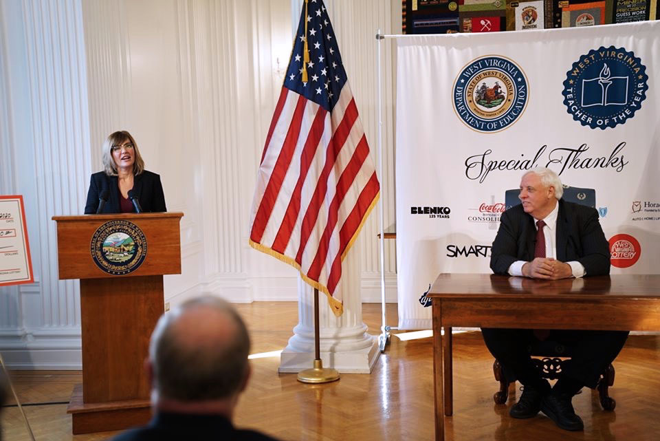 WV Gov. Jim Justice looks on as 2020 West Virginia Teacher of the Year Jennifer Schwertfeger is honored for her accomplishments..