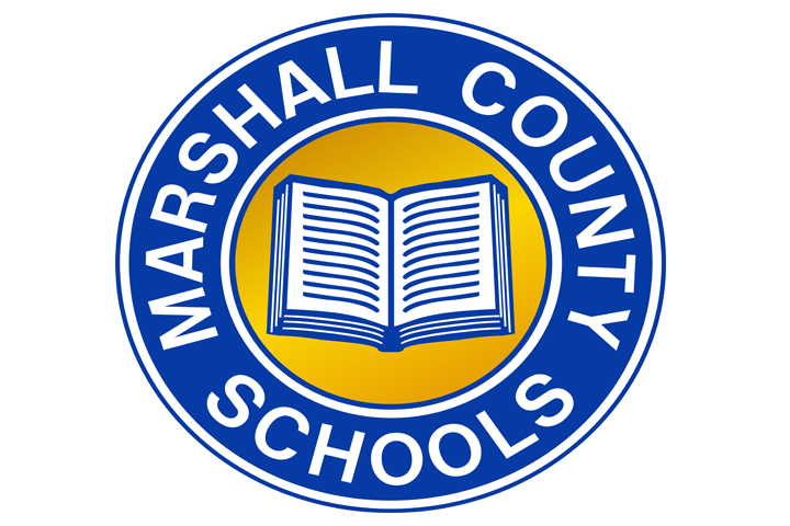 Marshall County Schools written in white over top of a blue background with a white book over top a yellow background. The logo is circular.