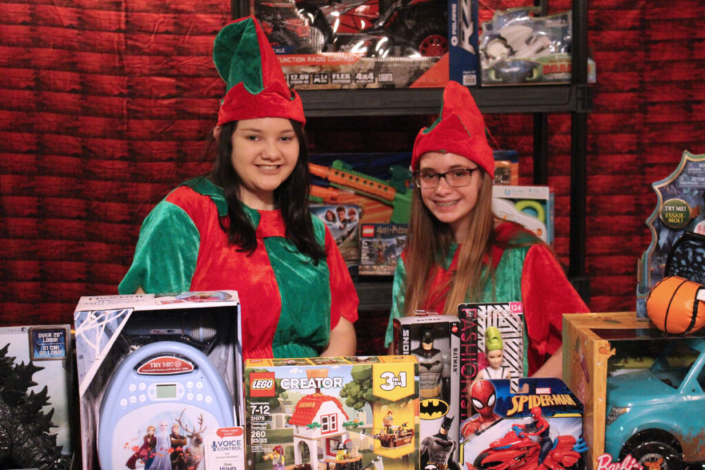 Pictured from left: Elf Leah and Elf Maria in the workshop making toys for Santa Claus.