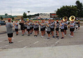 The JM Marching Monarch perform at Quaker Steak & Lube under the direction of Field Commander Brayden Snider.