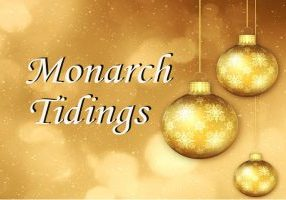 Brown and gold Monarch Tidings graphic with Christmas bulbs.