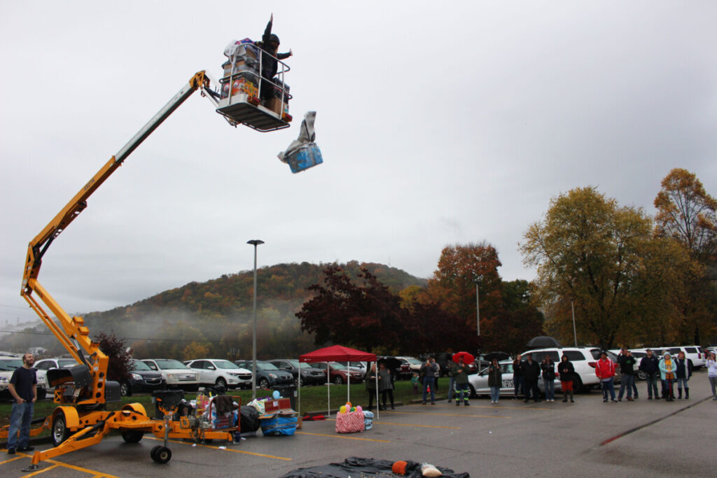 WLES Principal Julie Sturgill drops another student-created pumpkin protection device from 35 feet in the air.